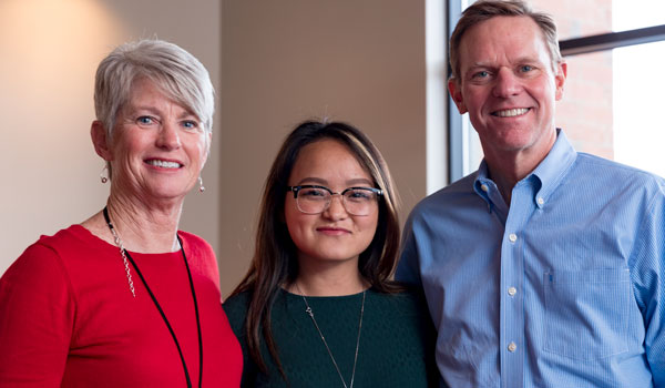 Colleen McCormick Malone, Lor Vang and Mike Malone pose for a photo.